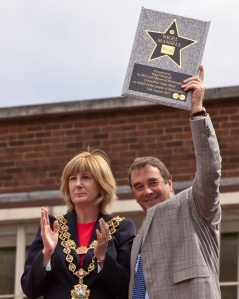 Nigel proudly holds up his plaque