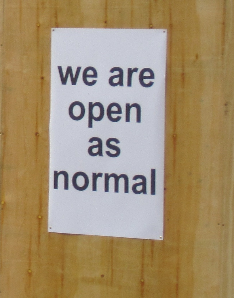 'We are open as normal' poster