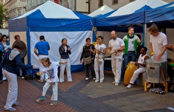 Band compelling children to dance in New Street