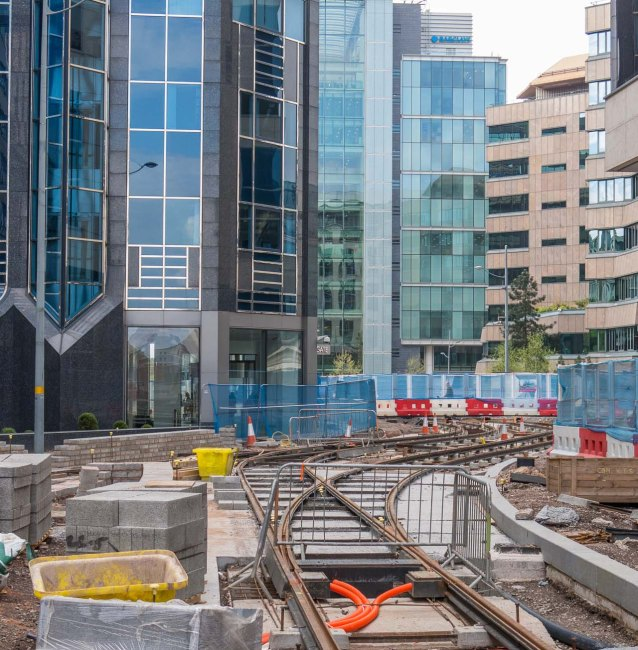 Crossover of tracks and curve around Colmore Gate office block on the left.