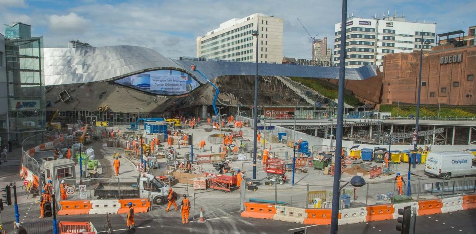 The view from Debenhams (in Bullring) over Smallbrook Queensway to the east facing station entrance shows a lot of work in progress at ground level.
