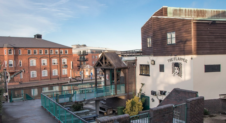 View from the lane over the Flappers open socialising space to the Cambrian Wharf