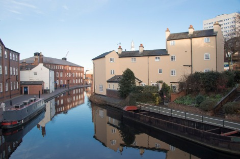 The lead into Cambrian Wharf with the rear of the Kingston Row Houses on the right